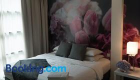 V花园酒店 - 吉隆坡 - 睡房