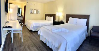 七阁楼旅馆 - 布兰森 - 睡房