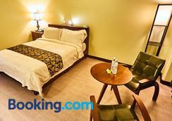 塞班塞伦提酒店 - 加拉班 - 睡房