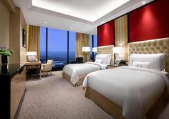 豪华事务酒店 - 万隆 - 睡房
