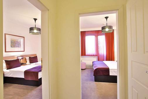 布达佩斯阿迪纳公寓酒店 - 布达佩斯 - 睡房