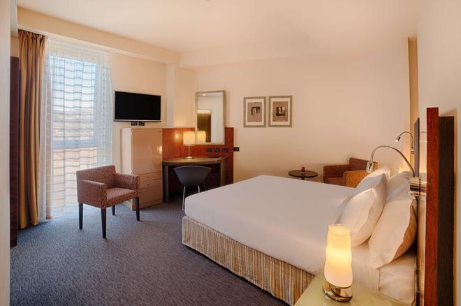 Nh伯格莫酒店 - 贝加莫 - 睡房