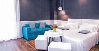 阿德里亚阿姆宾特别墅酒店 - 里米尼 - 睡房