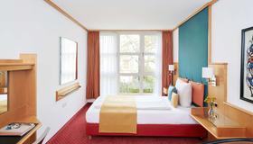 卡尔特奥多尔德拉格生活酒店 - 慕尼黑 - 睡房