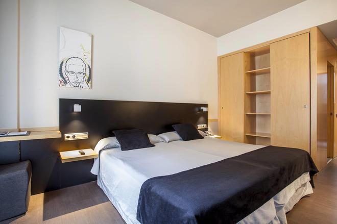 奥尼克斯里塞欧酒店 - 巴塞罗那 - 睡房