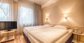柏林市美森怡居酒店 - 柏林 - 睡房