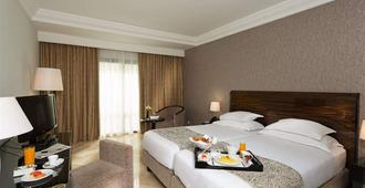 突尼斯湖西方酒店 - 突尼斯 - 睡房