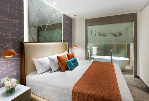 尼克洛德昂酒店及度假村-蓬塔卡纳卡利斯玛集团 - 蓬塔卡纳 - 睡房