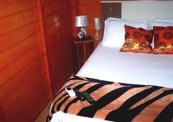 两恋人木屋旅馆 - Penha - 睡房