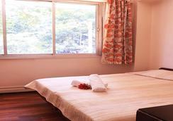 贝纳泽酒店 - 孟买 - 睡房