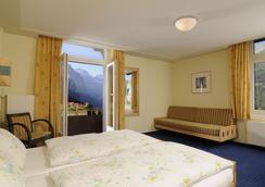 维多利亚劳伯霍恩Spa酒店 - Lauterbrunnen - 睡房