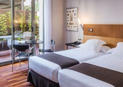 巴塞罗那兰布拉里沃利酒店 - 巴塞罗那 - 睡房