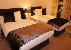 伦敦蓝宝石酒店 - 伦敦 - 睡房