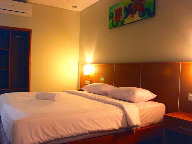 隆塔平房旅馆 - 库塔 - 睡房