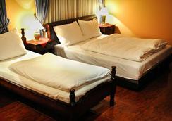 艾芙洛帕酒店 - 波德戈里察 - 睡房