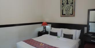 勒吉安宾馆 - 登巴萨 - 睡房