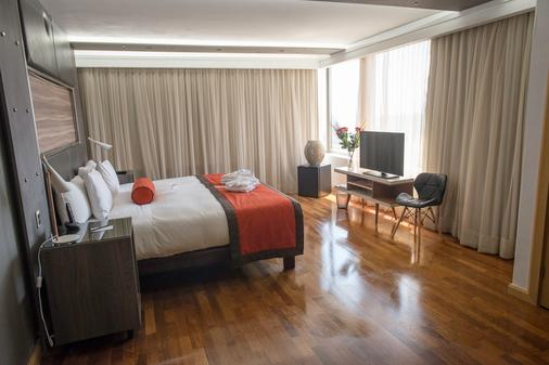大道套房酒店 - 圣地亚哥 - 睡房