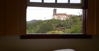 Brumas Ouro Preto Hostel - 欧鲁普雷图 - 睡房