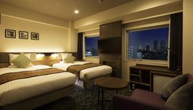 东京东兴酒店 - 东京 - 睡房