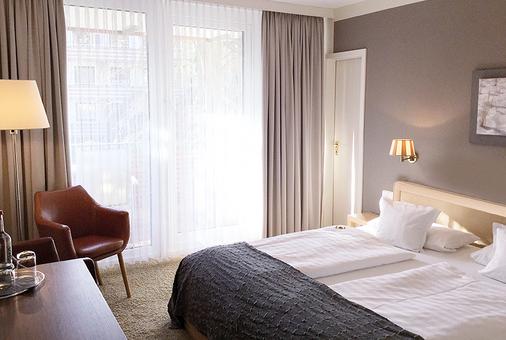 安科拉酒店 - 蒂门多弗施特兰德 - 睡房
