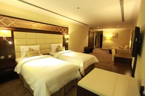 金色海滨酒店 - 多哈 - 睡房