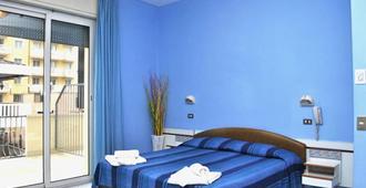 吉亚尼拉酒店 - 里米尼 - 睡房