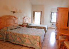 橘山海滩旅馆 - 拿骚 - 睡房
