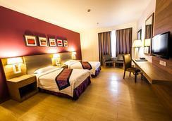 巴迪亚酒店 - 斯里巴加湾市 - 睡房
