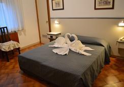 艾图菲酒店 - 锡耶纳 - 睡房