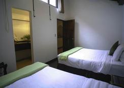 艾尔卡门酒店 - Antigua - 睡房