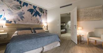 马拉加中心塞勒斯酒店 - 马拉加 - 睡房