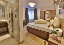 伽尼费格公寓酒店 - 索尔登 - 睡房