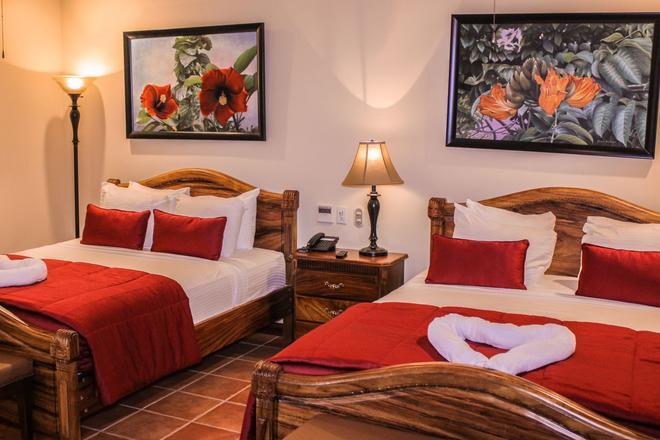 利里奥别墅酒店 - 曼努埃尔安东尼奥 - 睡房
