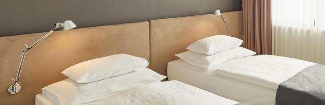 维也纳客房酒店 - 维也纳 - 睡房