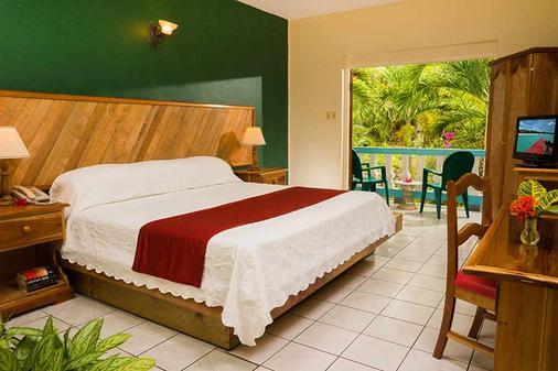 传奇海滩度假酒店 - 尼格瑞尔 - 睡房