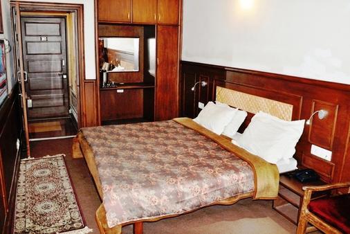 萨达弗酒店 - 斯利那加 - 睡房