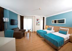 利马利姆拉酒店 - 凯麦尔 - 睡房