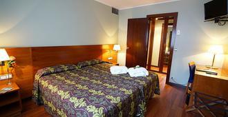 泽尼特外交酒店 - 安道尔城 - 睡房