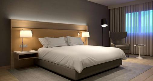瓦拉纳西丽筠酒店 - 瓦拉纳西 - 睡房