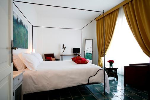 邓恩莫纳奇酒店 - 马拉泰亚 - 睡房