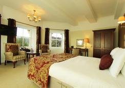 安多宫殿旅馆 - 皮特洛赫里 - 睡房