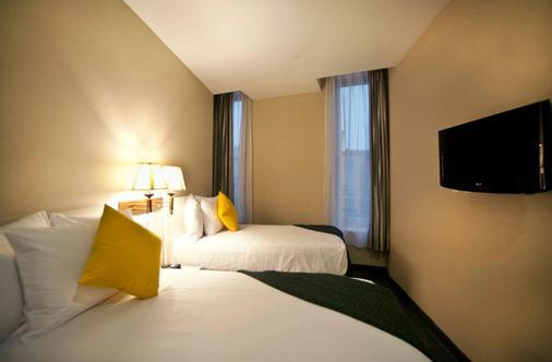 苏活花园酒店 - 纽约 - 睡房