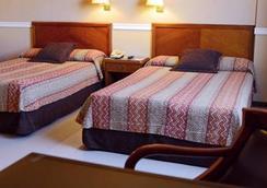 希尔高级套房酒店 - Asuncion - 睡房
