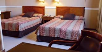 希尔高级套房酒店 - 亚松森 - 睡房