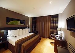 达斯乐思欧洲之星酒店 - 里斯本 - 睡房