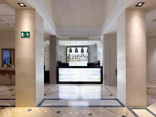 里瑞卡豪图萨酒店 - 马德里 - 柜台
