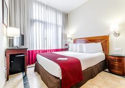 Exe莱塔纳皇宫酒店 - 巴塞罗那 - 睡房