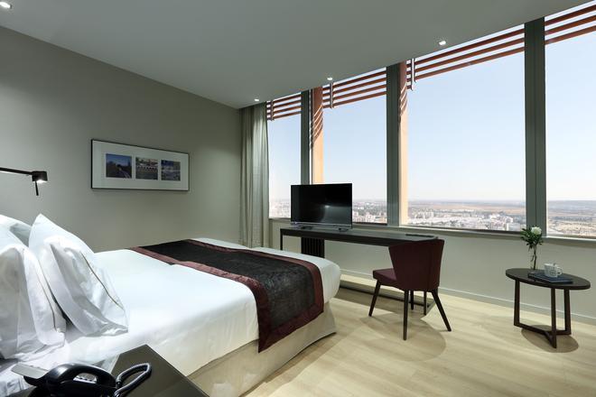 塞维亚托雷欧洲之星酒店 - 塞维利亚 - 睡房