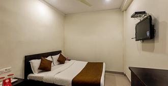 陛下宫酒店 - 孟买 - 睡房