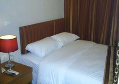 太阳城酒店 - 曼谷 - 睡房